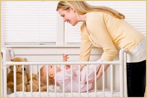 Уложить малыша в кроватку